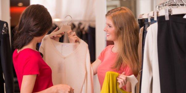 Two Women shopping choosing dresses
